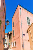 Typical pastel colored houses in Saint Tropez Stock Photo
