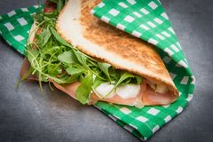 Typical piadina romagnola with ham, cheese and rocket Royalty Free Stock Photo