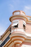 Typical pink buildinga with antique white windows in Monaco,France Royalty Free Stock Image