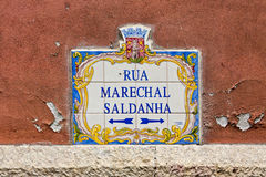 Typical plate with the name of street in Lisbon, Portugal Royalty Free Stock Photos
