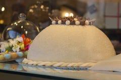 The typical, `polenta e osei` cake, Bergamo. The typical yellow sweet cake of bergamo, `polenta e osei`, in the showcase of a pastry shop Stock Image