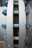 Typical polymer coated bolts and nuts connecting flanges. In petrochemical plant Stock Photography