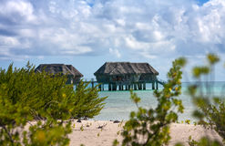 Typical Polynesian landscape -small houses on water. Stock Photo