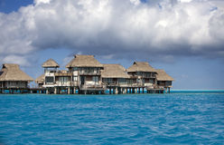 Typical Polynesian landscape -small houses on water. Stock Images