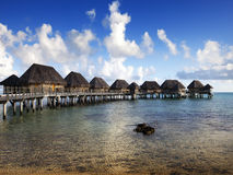 Typical Polynesian landscape -small houses on water Royalty Free Stock Images