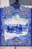 Typical Portuguese Azulejos (Blue tiles) depicting typical regional scenes Royalty Free Stock Images