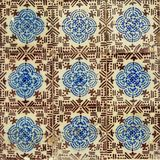 Traditionall portuguese azulejos tiles in blue and brown. Typical portuguese azulejos tiles with semi abstract floral design in in blue and brown royalty free stock image