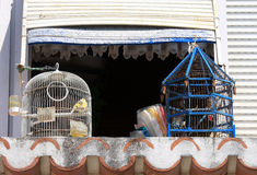 Typical portuguese balcony and bird cages Royalty Free Stock Image