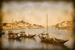 Typical portuguese boats used in the past to transport the famous port wine- Vintage and Retro Photo Effects added.  royalty free stock image