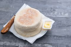 Typical portuguese bread of Madeira Bolo do caco with butter. On gray ceramic background royalty free stock photo