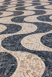 Typical portuguese cobblestone hand-made pavement calçada in Li Royalty Free Stock Photography