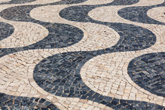 Typical portuguese cobblestone hand-made pavement calçada in Li Stock Image