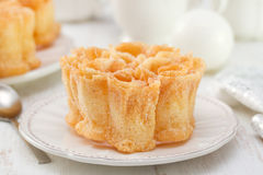 Typical portuguese dessert filhos on white plate Stock Images