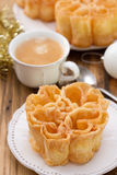 Typical portuguese dessert filhos on white plate Royalty Free Stock Image