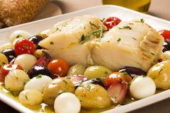 A typical Portuguese dish with codfish called Bacalhau do Porto. A typical Portuguese dish with codfish called Bacalhau do Porto in a original portuguese plate Royalty Free Stock Photo