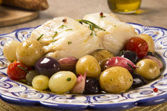 A typical Portuguese dish with codfish called Bacalhau do Porto. In a original portuguese plate. Cod Fish Prepared Royalty Free Stock Image
