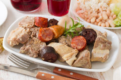 Typical portuguese dish cozido a portuguesa. And red wine Royalty Free Stock Photos