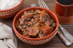 Typical portuguese dish feijoada. In ceramic bowl royalty free stock photos