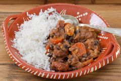 Typical portuguese dish feijoada with rice in ceramic bowl Stock Photo