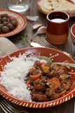 Typical portuguese dish feijoada with rice in ceramic bowl and red wine Royalty Free Stock Images