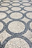 Typical Portuguese floor. .Typical Portuguese floor made of small pieces of colored stone in shape of circles and arcs. Typical Portuguese floor. Typical royalty free stock images