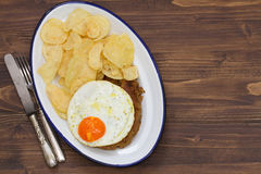 Typical portuguese sausage alheira with fried egg Stock Photo