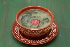 Typical portuguese soup caldo verde in brown ceramic dish Stock Image