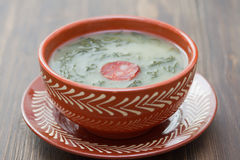 Typical portuguese soup caldo verde in ceramic dish Stock Photography