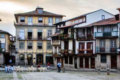 Guimares, Braga, Portugal. A typical Portuguese square in the historic center with terraces and portuguese drinking a drink Stock Photography
