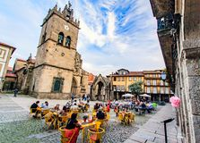 Guimares, Braga, Portugal. A typical Portuguese square in the historic center with terraces and portuguese drinking a drink Stock Image