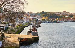 Typical portuguese wooden boats, called `barcos rabelos ` transporting wine barrels on the river Douro with view on Villa Nova de. Typical portuguese wooden stock photos