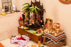 Typical Prayer Room Hindu South Indian Family Home. This is how a typical 'Puja Room' in any Hindu South Indian Family Home looks like after a traditional puja Stock Photography