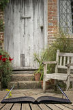 Typical quintessential old English country garden image of wooden chair next to vintage back door concept coming out of pages in royalty free stock photos