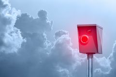A typical radar trap, speed trap, speed camera in front of cloudy sky.  Stock Photography
