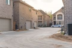 Rear entry garage of brand newly built house in Texas, USA. Typical rear entry garage of brand newly built house in Texas, USA. Row of detached lot with garage stock image