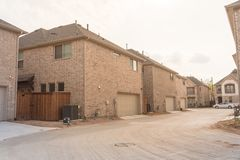 Rear entry garage of brand newly built house in Texas, USA. Typical rear entry garage of brand newly built house in Texas, USA. Row of detached lot with garage stock photo