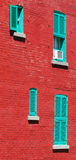 Typical red brick wall in Montreal, Canada. This house is located in Montreal, Canada, near marché Maisonneuve. Lens: SIGMA  70-200mm/2.8 EX DG APO HSM Stock Images