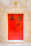 Typical red door Maltese house in La Valletta.  Royalty Free Stock Photos