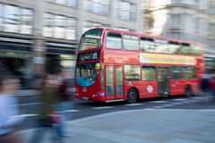 Typical red double decker bus in London. A typical red London double decker bus in motion on it's way to St. Pauls's cathedral. Street blurred out by motion Royalty Free Stock Photo