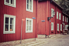 Typical red houses in open air museum Wadkoping, Sweden Stock Photo