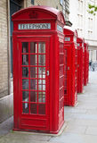 Typical red London phone booth. A group of typical red London phone cabins Stock Photo