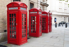 Typical red London phone booth. A group of typical red London phone cabins Stock Photos