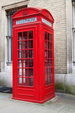 Typical red London phone booth. A typical red London phone cabin Stock Photography