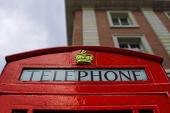 A typical red London phone booth. The traditional red London telephone Royalty Free Stock Photo