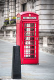 Typical red phone booth in London, UK. A typical red phone booth in the city of London, capital of the United Kingdom Royalty Free Stock Image