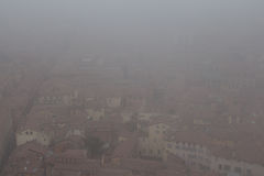 Typical red roofs of Bologna in a foggy day. View from Asinelli Tower. Emilia Romagna , Italy. Royalty Free Stock Image