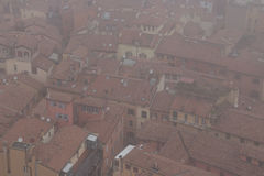 Typical red roofs of Bologna in a foggy day. View from Asinelli Tower. Emilia Romagna , Italy. Stock Images