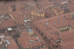 Typical red roofs of Bologna in a foggy day. View from Asinelli Tower. Emilia Romagna , Italy. Stock Photography