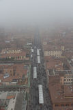 Typical red roofs of Bologna and a market in a foggy day. View from Asinelli Tower. Emilia Romagna , Italy. Royalty Free Stock Photos