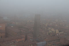 Typical red roofs of Bologna and a tower in a foggy day. View from Asinelli Tower. Emilia Romagna , Italy. Royalty Free Stock Photos